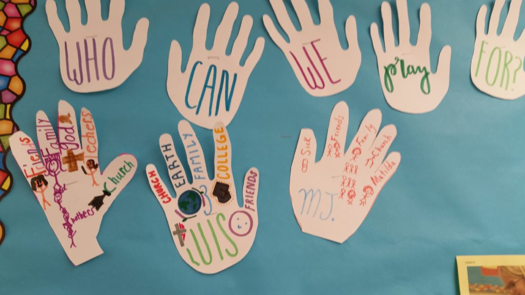 The Sunday School children share their prayer requests on cutouts of their hands.